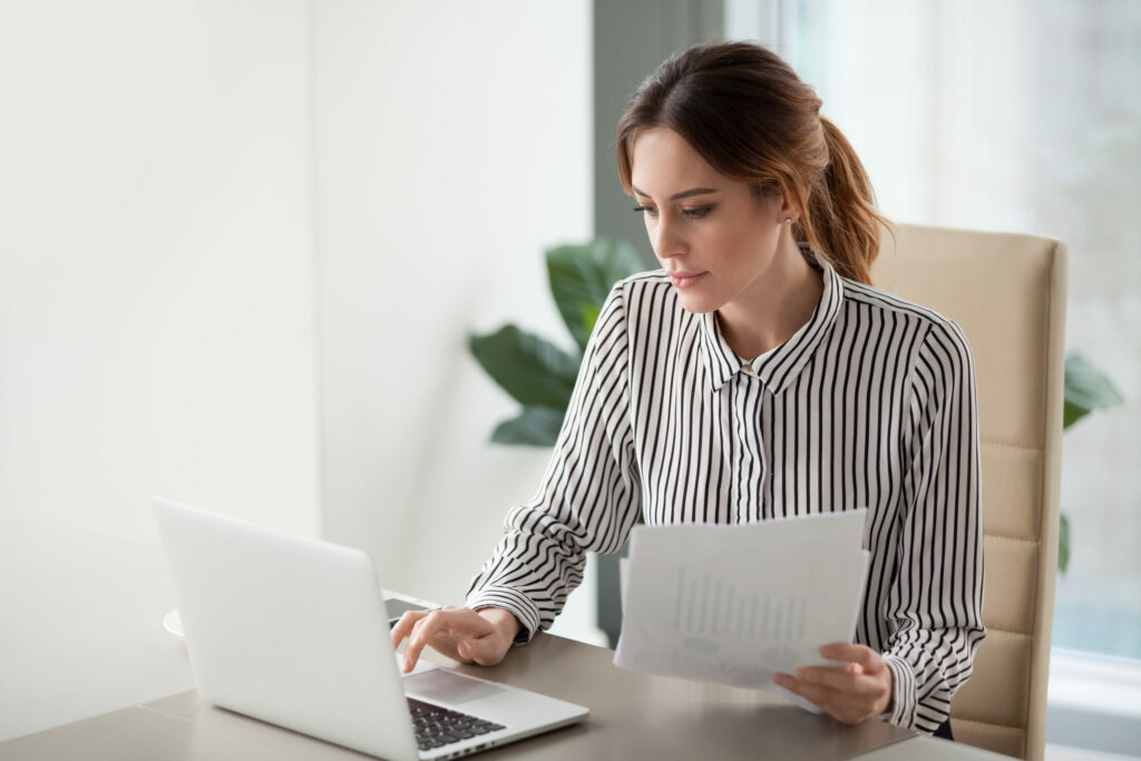 A woman working on a laptop.